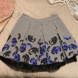Polka dot skirt with blue flowers